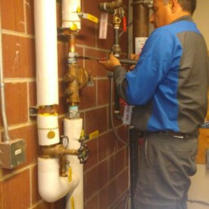 plumber-hard-at-work-e1512061951186-576x1024